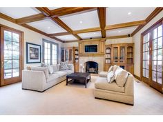 27461 Sherlock Rd, Los Altos Hills, CA - Luxury Real Estate - Silicon Valley - Arthur Shairf - Sotheby's - Living Room - Leaded Glass Windows - Contemporary - Interior Design - Family Room - Coffered Ceilings - French Doors - Stone Fireplace - Beams - Neutral