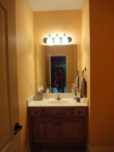 The typical powder room, that half bath in your home with just a sink, toilet, and mirror, only averages about … Small Attic Bathroom, Basement Bathroom, Bathroom Ideas, Home Design, Blue Powder Rooms, Powder Room Vanity, Downstairs Toilet, Living Room Designs, Designer