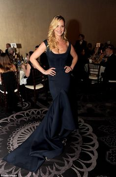 Simply stunning: Katherine Heigl showed off her curves in a tight black mermaid dress...