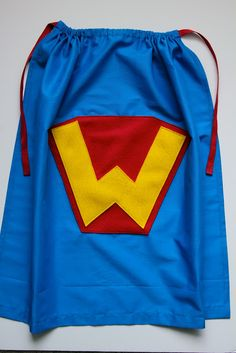 How to Sew an Easy  Super Hero Cape. I could do a better emblem but this is perfect for her team.