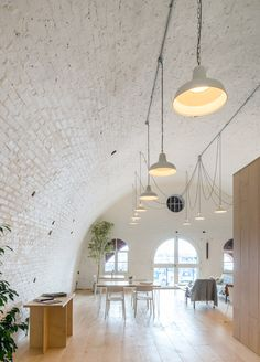 Set under an old brick archway on the Kent coastline, this timber-lined cafe by Haptic takes its design cues from Scandinavian architecture and beach huts Scandinavian Cabin, Scandinavian Architecture, Commercial Design, Commercial Interiors, Cafe Interior, Interior And Exterior, Brick Archway, Brick Walls, Quonset Homes