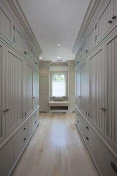 Cottage Hallway with Crown molding, Window seat, KitchenCraft Glendale Cabinet Door Style, Laminate floors