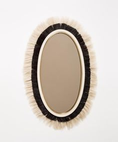 THE STUD MIRROR WE WANT THIS STUD IN EVERY ROOM. HORSE HAIR AND LEATHER COME TOGETHER TO FORM A MASCULINE FRAME AROUND A LARGE OVAL MIRROR. THIS DAPPER STUD WOR