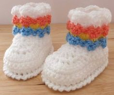 Sweet Textured Stitch Booties Free Crochet Pattern Design by Justcrochet http://theyarnbox.com/sweet-textured-stitch-booties-free-crochet-pattern/
