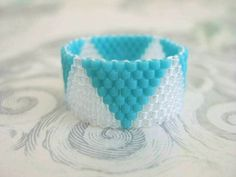 Peyote Ring in Turquoise and Crystal  Beaded Beadwork Seed Bead Delica - size 8. $14.00, via Etsy.