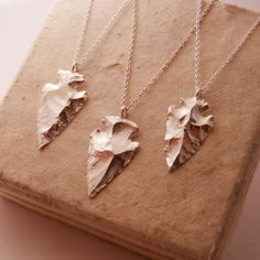 Arrowhead Necklace by Blue Dot Jewelry. Available at Fairgoods: http://www.fairgoods.com/products/silver-arrowhead-necklace