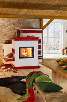 The parlor, the beautiful stove – and the modern life. A wood fire fits everywhere and even in a modern, traditional chalet. With wooden floorboards, wooden bench and glass front. - Home Decor Ideas Modern Fireplace, Living Room With Fireplace, Fireplace Design, Interior And Exterior, Interior Design, Orange Kitchen, Stove Fireplace, Earth Homes, Wood Interiors