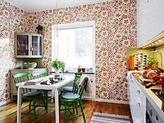 Josef Frank wallpaper.  A colorful,  flower pattern that makes the kitchen look vibrant and cheerful!