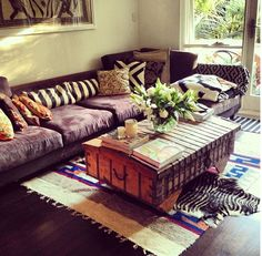 Eclectic bohemian style living space. Mixed prints, zebra rug & vintage chest.
