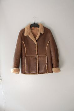 Check out this item in my Etsy shop https://www.etsy.com/listing/249767124/vintage-real-sheep-skin-shearling-jacket
