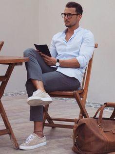 Shop this look on Lookastic: https://lookastic.co.uk/men/looks/light-blue-long-sleeve-shirt-charcoal-dress-pants-beige-low-top-sneakers/18251   — Light Blue Long Sleeve Shirt  — Charcoal Dress Pants  — Beige Low Top Sneakers  — Brown Leather Holdall