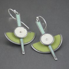 "These earrings are hand made using vintage car metal. The original car paint has been left intact and unaltered. The chartruse green is off a 72 Plymouth Roadrunner, the white from a 64 Ford Fairlane and the turquoise from a 58 Dodge D-100.Hung on sterling silver ear wires, the total length, including the ear wire, is about 1 3/4"" long and are 7/8"" wide."