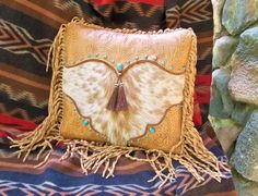 A new hand crafted leather and hair-on cowhide pillow from Stargazermercantile.com!  Western art pillow vintage style tan tooled by stargazermercantile, $275.00