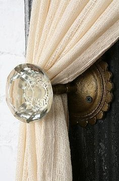 Crystal door knobs as curtain hook.  I love doorknobs!!