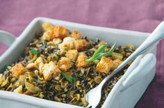 """Wild Rice and Sage """"Stuffing"""" Toasted bread croutons add a bread-stuffing texture to seasoned wild rice."""