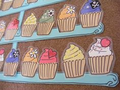 This is my class behavior management reward chart. Each day children can earn a cupcake to put onto the cake stand. And when they reach the top they are treated to a whole class reward! :D