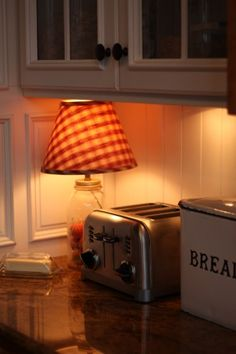 Adding a lamp under the cabinets adds a warm ambiance.