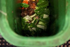Food scraps are seen in a compost bin at a San Francisco restaurant. A new report ranks centralized composting as a top strategy for keeping food waste out of landfills, where it emits methane, a powerful greenhouse gas.