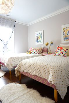 Splurge: These curtains from Anthropologie brought in some sophistication in the fabric and fun in their pompom detail in this girls room.