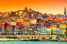 #Porto, #Portugal is one of the most underrated European cities according to Harper's Bazaar 27.07.2015 | It's hard not to fall in love with Portugal's romantic second city, Porto. Located on the coast of the Rio Douro, the portside town is a melting pot of colours and architectural styles; from the pastel townhouses to the medieval bell towers, the extravagant baroque churches to the classical beaux-arts state buildings.