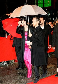 Anne Hathaway kept dry (courtesy of hubby Adam Shulman) heading to dinner in Paris after the premiere of Les Miserables Feb. 6.