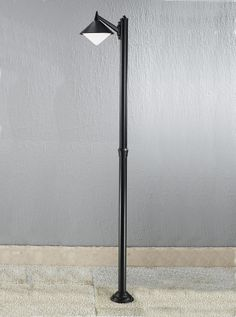 EXT6587 Sera modern Italian single lamp post, black aluminium. Italian die-cast aluminium matt black exterior fitting with opal polycarbonate difuser. Outdoor IP43 Rated 1 x 75w E27 Lamp not included Height- 220cm Diameter- 45cm BRAND- Franklite REFERENCE- EXT6587 AVAILABILITY: 3-4 Working Days