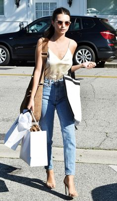 On Ratajkowski: The Reformation Camille Top ($98); A.L.C. Sadie Hobo Bag ($795); Levi's Vintage Clothing 1969 606 Customized Jeans ($198); Stuart Weitzman Nudist Sandals...