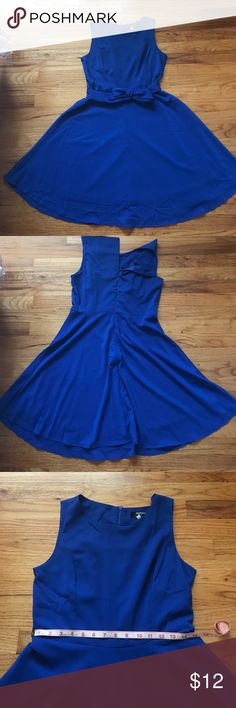 Bright blue knee length dress Medium bright blue knee length dress with a sash tie detail. Hidden zip closure in the back. You can use the blue sash or use a belt to style. High neckline makes this dress suitable for the office! In excellent condition, worn once and washed. Dresses