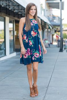 """""""The Way I Feel Dress, Navy"""" This dress is gorgeous and makes us feel all sorts of good feelings! Those vibrant flowers leap right off that dark navy background! We love the classic shift cut too! #newarrivals #shopthemint"""
