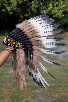 Indian style headdress, short length Handmade with feathers, Hat circumference 59 cm approx, 23,2 inches approx Band: The geometric patterns of the decorative band made with beads on the front of the headdress may have some variations depending on what we have in stock at the time of
