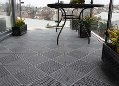 Piazza Floor Tiles for Balconies and Roof Terraces. Free draining, easy install, lightweight and UV stable. Available from Tacttiles