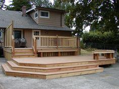 bottom section. big wide stairs   NW Custom Deck | Seattle's Deck Builder - Portfolio