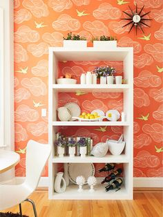 Accents on Display: Push a backless bookcase against a patterned wall to create an artful visual effect. If you can't find a backless bookcase, hang simple shelves. Keep the display monochromatic to add even more drama to the room. Orange Wallpaper, Diy Wallpaper, Colorful Wallpaper, Crazy Wallpaper, Amazing Wallpaper, Temporary Wallpaper, Bookshelf Organization, Storage Shelves, Deep Shelves