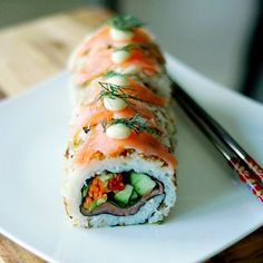 Salmon Sushi, filled with sun dried tomato, rocket, cucumber, spinach and avocado. Exquisitely 'clean' taste yet satisfyingly filling!
