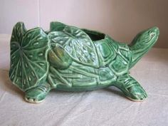 Why i need a bigger house. To display all my pottery. Have fave turtle like this.