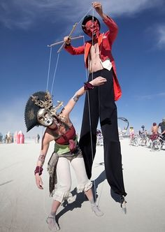 Man-Sized Marionette  Two performance artists from the Vancouver troupe 64 Arts at Burning Man 2012