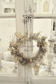 French Country - Creamy white french doors with a dried floral wreath