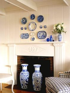I Love Cobalt & white!  Plates Wall Art: Plate hangers are inexpensive, readily available in hardware stores and antiques malls. Clip the hooks onto collectible plates and platters to hang them up in an attractive display over a mantel.