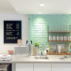 Spent most of the afternoon sipping coffee at @lilsistercoffee today. Isn't this robins egg blue wall the cutest?!? ☝