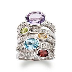 Our set of five rings shimmers with amethyst, peridot, citrine, blue topaz and garnet each presented in a different band with white topaz adding extra sparkle! Wear together or split the set up for extra fashion looks. #stacked