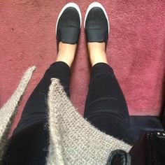 Cute comfy slip-on shoes in black.