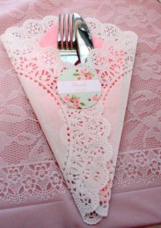 Use a paper doily as a cute way to place knives and forks on a Vintage Tea table