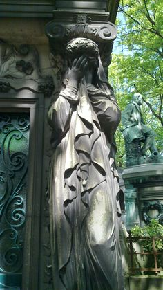 Weeping statue in the Pere Lachaise cemetery in Paris.