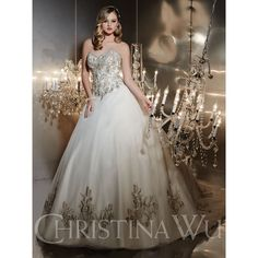 Christina Wu Style 15534 Strapless Heavily Beaded bodice with dangle beads. Basque Waist. Heavily embroidered detail on the tulle skirt. Lace-up back