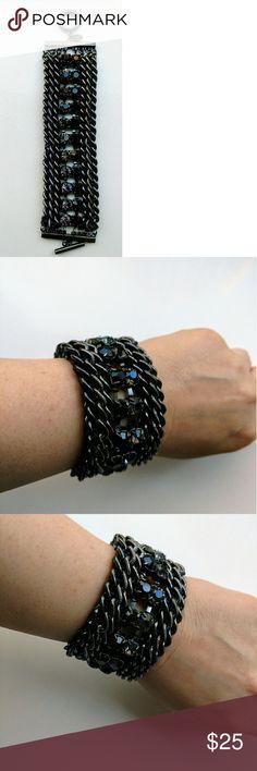 "Gunmetal Rhinestone Bracelet NWOT Rocker Chic Gunmetal bracelet with one row of black stones and one row of grey see thru stones.  6"" length for body of bracelet. Express Jewelry Bracelets"