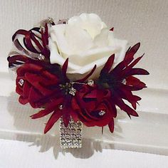 Beautiful wrist corsages for wedding, proms and special occasions. Silk, Artificial wedding flowers on wristlet bands. Wrist Corsage Wedding, Prom Corsage And Boutonniere, Wedding Bouquets, Boutonnieres, Red Corsages, Flower Corsage, Prom Flowers, Wedding Flowers, Wristlet Corsage