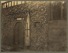 Carved wood wall and doors possibly an iconostasis in the Coptic Church of Saint Barbara Cairo