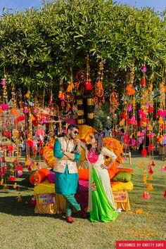 Mehendi Decor - Hanging Pom Poms From Tree Decor Desi Wedding Decor, Wedding Mandap, Wedding Stage Decorations, Wedding Themes, Flower Decorations, Wedding Receptions, Wedding Bride, Wedding Flowers, Mehendi Decor Ideas