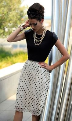 Layered pearls add a vintage flair to any outfit
