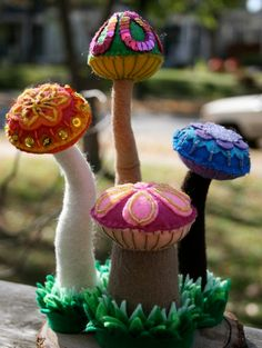 Beaded, sequined and embroidered felt mushrooms inspired by Alice In Wonderland. Amazing detail work!